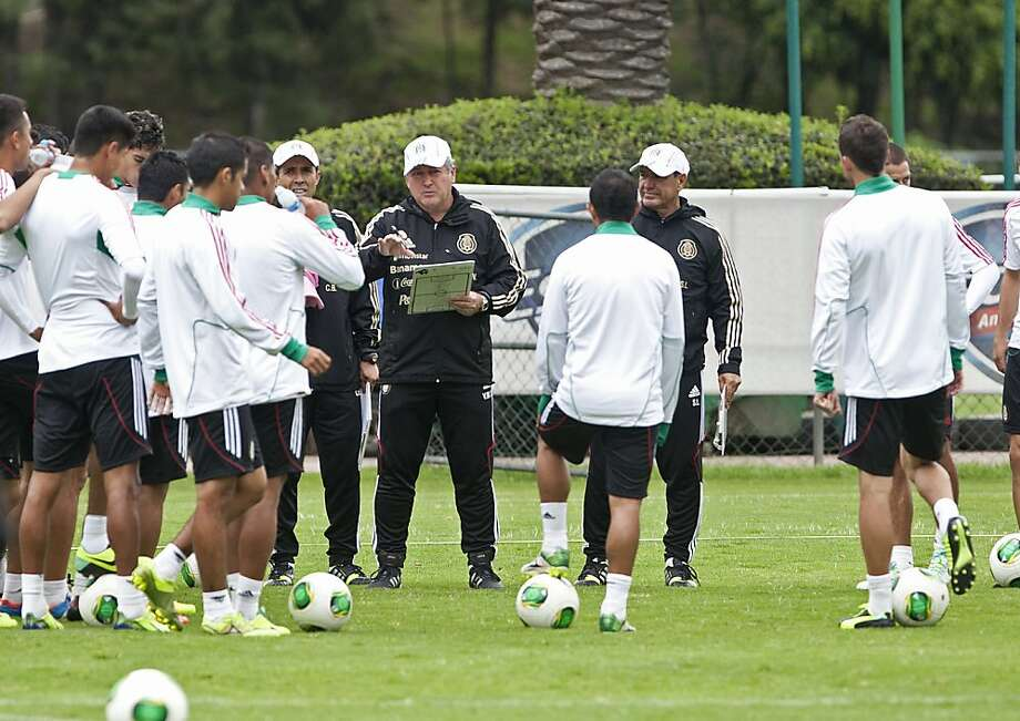 Victor Manuel Vucetich (center) talks with players Monday in preparation for Friday night's critical World Cup qualifier. Photo: Christian Palma, Associated Press