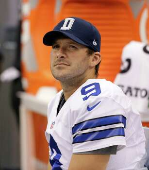 Dallas Cowboys quarterback Tony Romo (9) sits on the bench late in an NFL football game against the St. Louis Rams, Sunday, Sept. 22, 2013, in Arlington, Texas. The Cowboys won 31-7. (AP Photo/Tony Gutierrez) Photo: Tony Gutierrez, Associated Press / AP