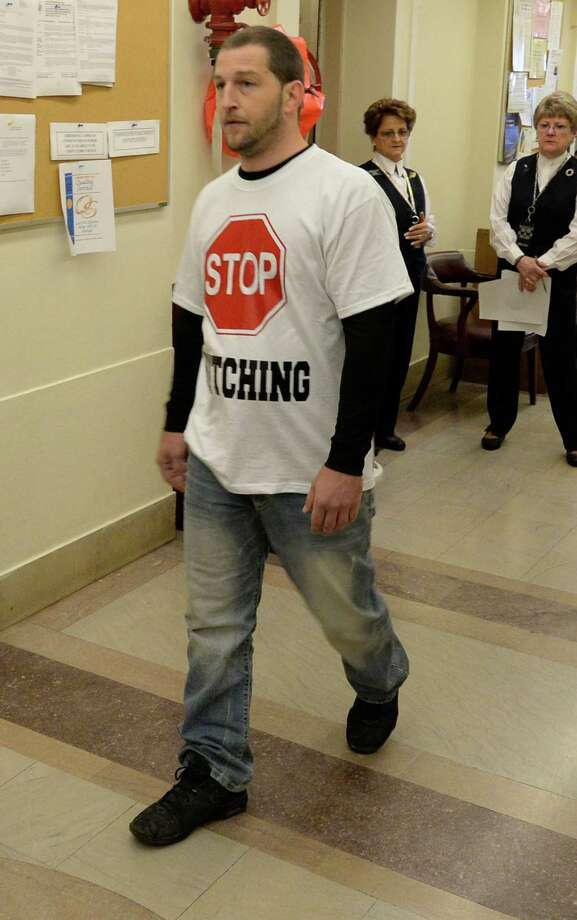 Larry Ahrens, the alleged central figure, in a plot to firebomb the property of his ex-girlfriend's new boyfriend, walks toward Courtroom II for his sentencing Thursday morning, Oct. 10, 2013, in the Schenectady County Courthouse in Schenectady, N.Y.   (Skip Dickstein / Times Union) Photo: Skip Dickstein