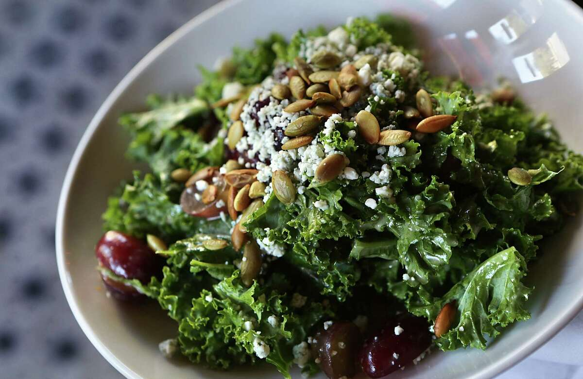 In the kale salad, sliced grapes, toasted pumpkin seeds and Gorgonzola are topped with a light dressing.