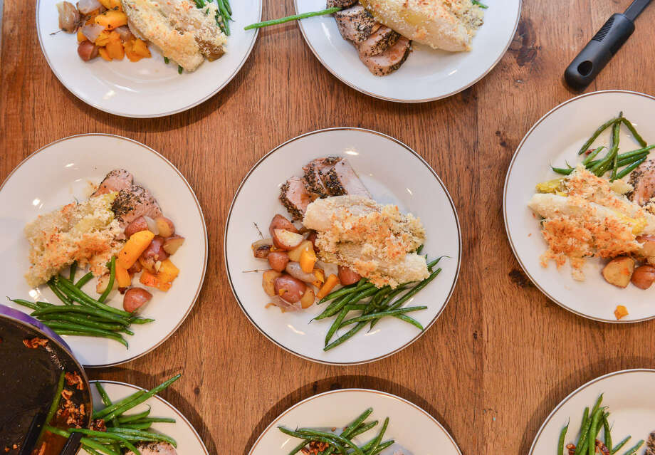 The wives of this supper club plated each course in the kitchen, including a recipe for braised Belgian endive gratin with roasted autumn vegetables. Photo: Photos By Robin Jerstad / For The Express-News
