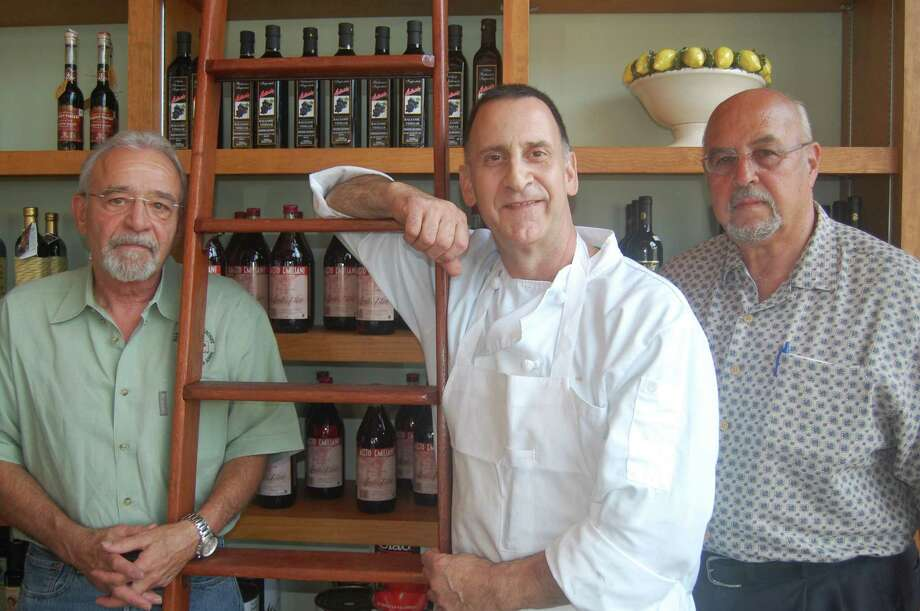 Dan Martinelli (from left), chef Rick Perno and Robert Corbo opened Fratello's Italian Market & Deli,  on Broadway.
