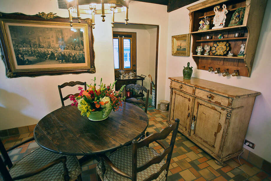 A lithograph of the Duke of Wellington's celebration, an antiquing find, hangs in John and Garda Boswell's dining room. The floor is Batchelder tile. Photo: Photos By Danny Warner / For The Express-News