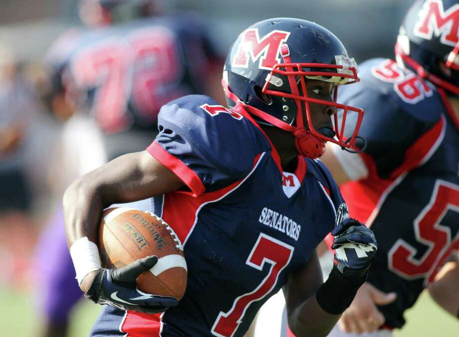 Brien McMahon's Kentrell Snider scoots around right end for a touchdown during first half football action in Norwalk. Led by a strong special teams play, the Senators held on to win, 21-15. © J. Gregory Raymond for The Advocate Photo: J. Gregory Raymond / Stamford Advocate Freelance;  © J. Gregory Raymond