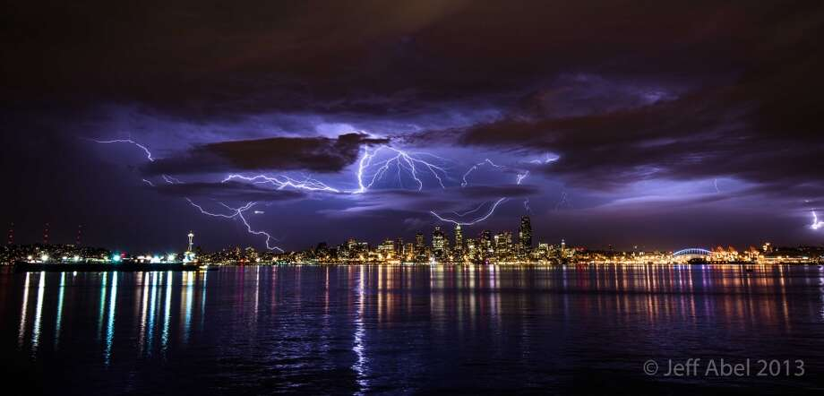 Lighting in Seattle, Sept. 2013  Thunderstorms in Seattle are rare, and I couldn't miss an opportunity to capture one on camera. I set up my tripod after sunset, and kept an eye out for approaching storms.   As a large storm approached Seattle, it put on an incredible show of light and sound, which stretched across the horizon.   Standing atop a dock in Elliott Bay, a feeling of excitement and nervousness rushed over me. Soon after, this one strike, comprised of several interconnected lightning bolts, lit up the entire sky.   I stood in awe of the spectacular display Mother Nature had just given me. It was an immensely powerful moment to witness, and I feel fortunate to be able to share it with you.  -- Jeff Abel Photo: Jeff Abel