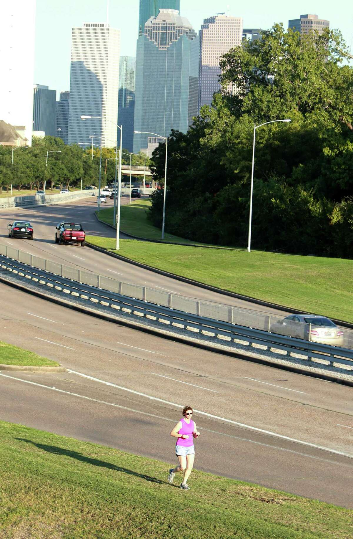 Trish Sullivan runs along an uncompleted from the Waugh on ramp to Memorial on Thursday, Oct. 10, 2013, in Houston.