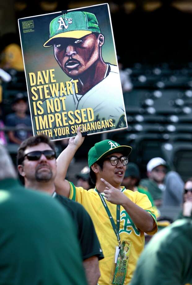 A's fan Ian Sarabaen of Redwood City holds a poster of former A's pitcher Dave STewart who is throwing out the first pitch this evening, as the Oakland Athletics prepare to take on the Detroit Tigers in game 5 of the American League Division Series at the O.co Coliseum on Thursday Oct. 10, 2013, in Oakland, Calif. Photo: The Chronicle
