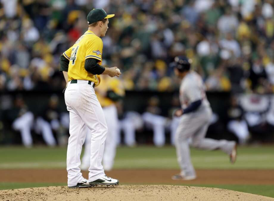 Oakland Athletics starting pitcher Sonny Gray watches as Detroit Tigers Miguel Cabrera rounds the bases after he scored a two run home run in the fourth inning of Game 5 of an American League baseball division series in Oakland, Calif., Thursday, Oct. 10, 2013. (AP Photo/Ben Margot) Photo: Associated Press