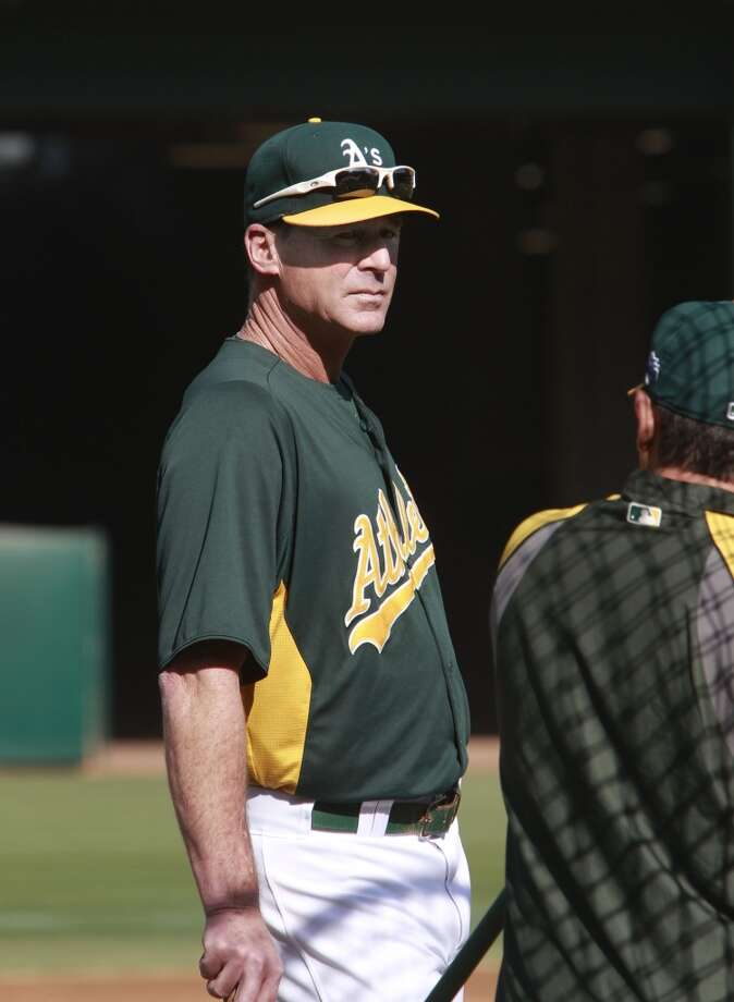 A's manager Bob Melvin keeps a watch on batting practice before the start of the game, as the Oakland Athletics prepare to take on the Detroit Tigers in game 5 of the American League Division Series at the O.co Coliseum on Thursday Oct. 10, 2013, in Oakland, Calif. Photo: The Chronicle