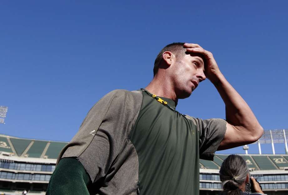 A's pitcher Grant Balfour ,(50) finishes up practice before the start of the game, as the Oakland Athletics prepare to take on the Detroit Tigers in game 5 of the American League Division Series at the O.co Coliseum on Thursday Oct. 10, 2013, in Oakland, Calif. Photo: The Chronicle