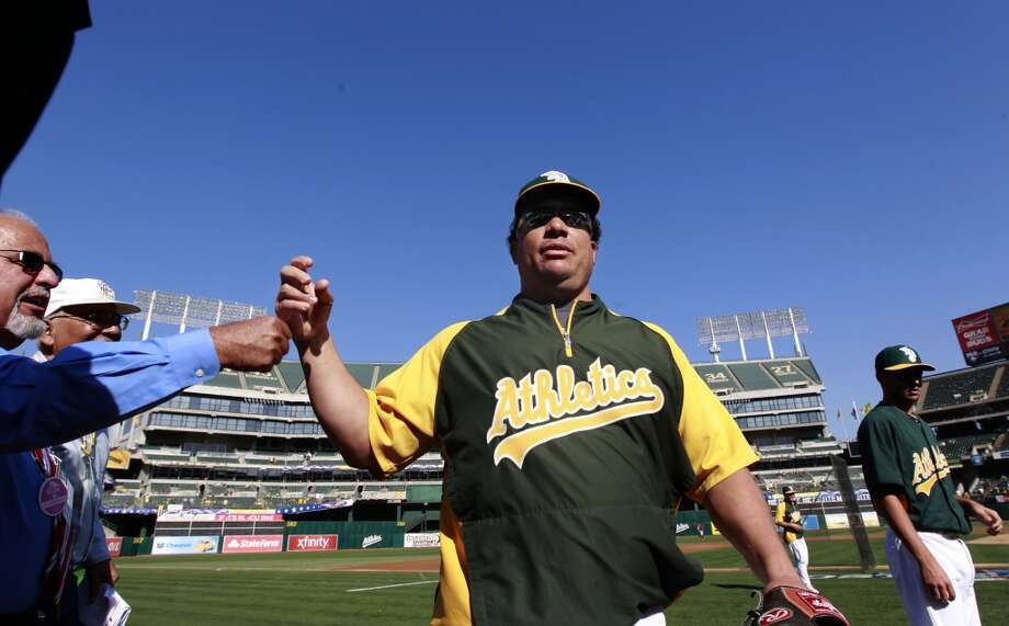 A's pitcher Bartolo Colon,(40) heads for the clubhouse after afternoon pre-game practice, as the Oakland Athletics prepare to take on the Detroit Tigers in game 5 of the American League Division Series at the O.co Coliseum on Thursday Oct. 10, 2013, in Oakland, Calif. Photo: The Chronicle
