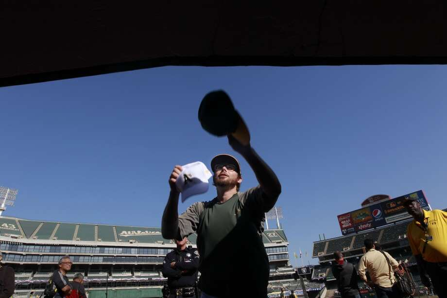 A's Eric Sogard, (28) signs autographs before the game, as the Oakland Athletics prepare to take on the Detroit Tigers in game 5 of the American League Division Series at the O.co Coliseum on Thursday Oct. 10, 2013, in Oakland, Calif. Photo: The Chronicle
