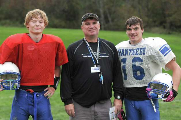 Coach Ron Jones , center, quarterback Garrett Wright, left, and running back Brandon Hodges during Hoosick Falls High School football practice on Thursday Oct. 10, 2013 in Hoosick Falls, N.Y. (Michael P. Farrell/Times Union) Photo: Michael P. Farrell / 00024203A