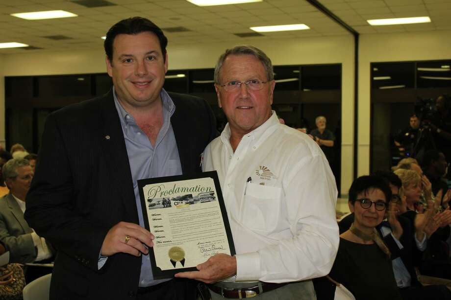 Missouri City Mayor Allen Owen, right, presented Kevin Barker, of the Texana Center, with a proclamation stating that October is National Disability Employment Awareness Month. Photo: Courtesy Of The City Of Missouri City