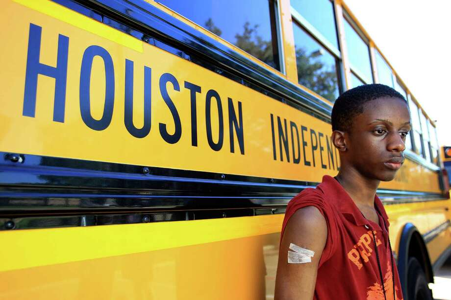 Barinum Lenu, a Westside freshman, was cut last month when he helped fight off a man who was trying to abduct another student. Photo: Karen Warren, Staff / © 2013 Houston Chronicle