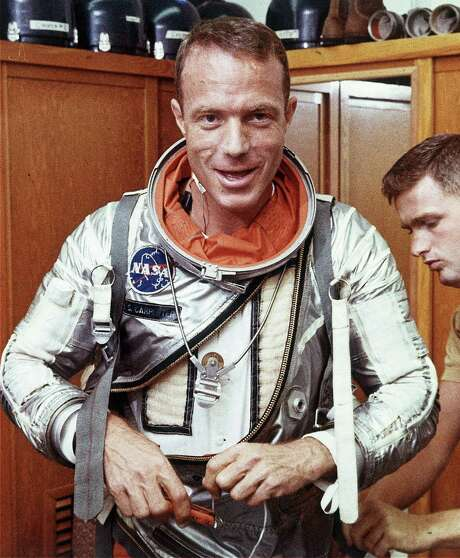 Astronaut Scott Carpenter has his space suit adjusted by a technician in Cape Canaveral, Fla., in this photo from 1962. Carpenter, the second American to orbit the Earth and one of the last two surviving Mercury astronauts, died Thursday. Photo: Associated Press