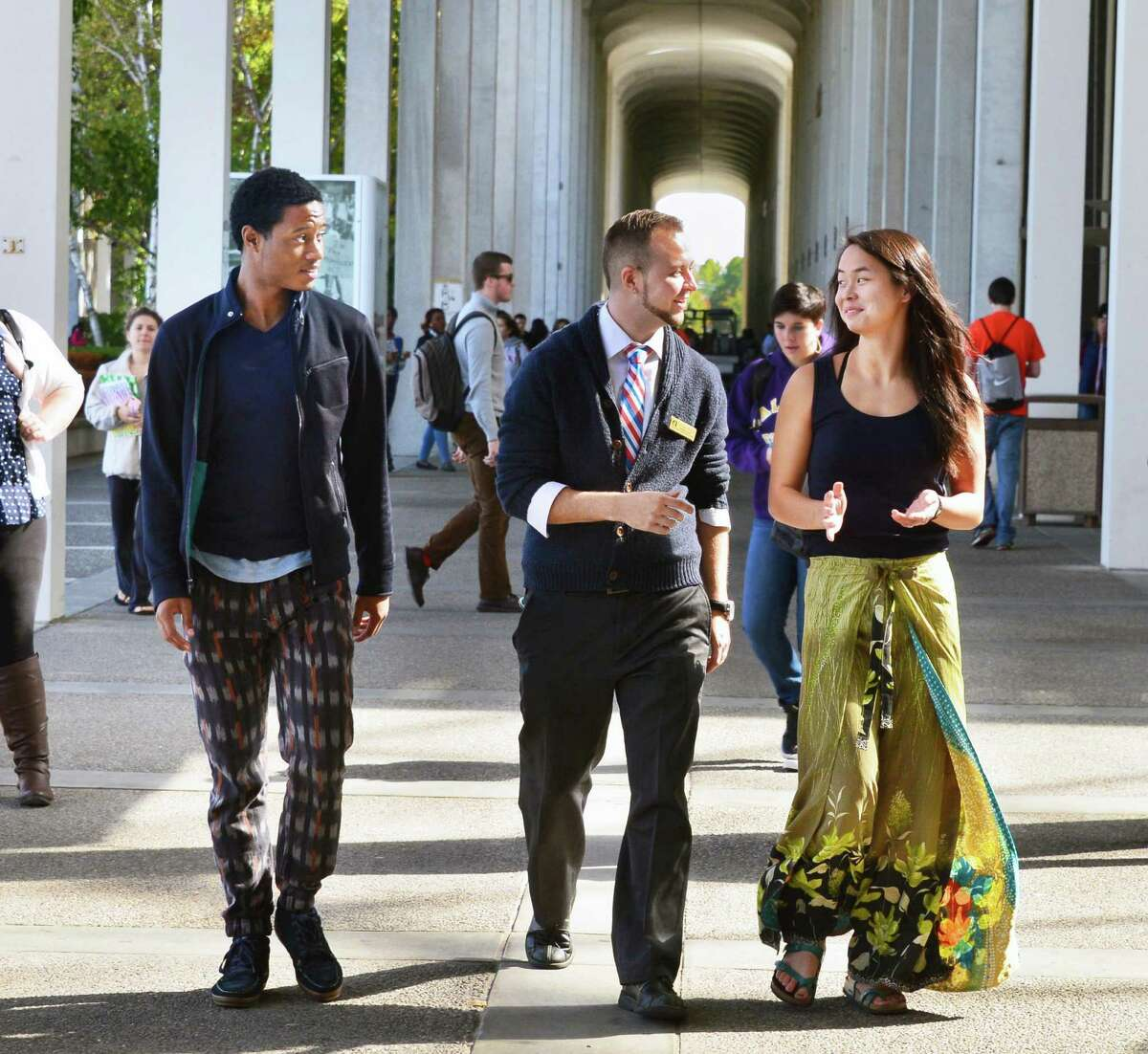Courtney D'Allaird, center, coordinator, gender and sexuality resource center at UAlbany, walks with students Jonathan Whyte Dixon, left, and Meng Halvorson-Phelan on campus Wednesday Oct. 9, 2013, in Albany, NY. (John Carl D'Annibale / Times Union)