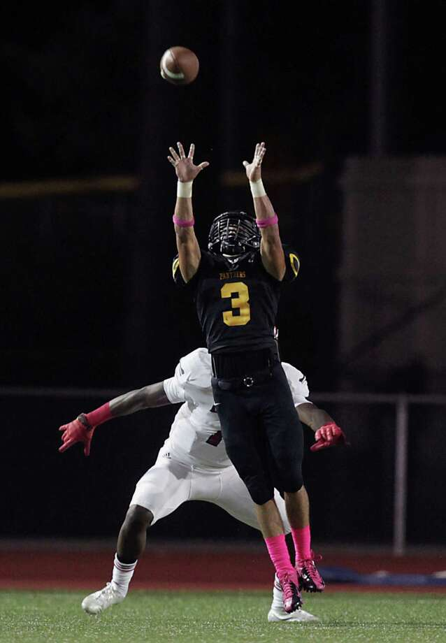 Klein Oak's Tristen Gomez intercepts an Atascocita pass during the second quarter of high school football game action at Klein Memorial Stadium Thursday, Oct. 10, 2013, in Houston. Photo: James Nielsen, Houston Chronicle / © 2013  Houston Chronicle