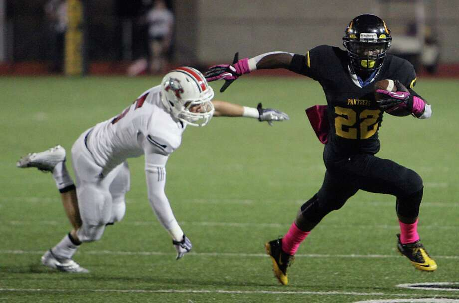 Klein Oak's Larenzo Stewart right, breaks away from Atascocita's JP Rodriguez right, to pick up extra yardage during the second quarter of high school football game action at Klein Memorial Stadium Thursday, Oct. 10, 2013, in Houston. Photo: James Nielsen, Houston Chronicle / © 2013  Houston Chronicle