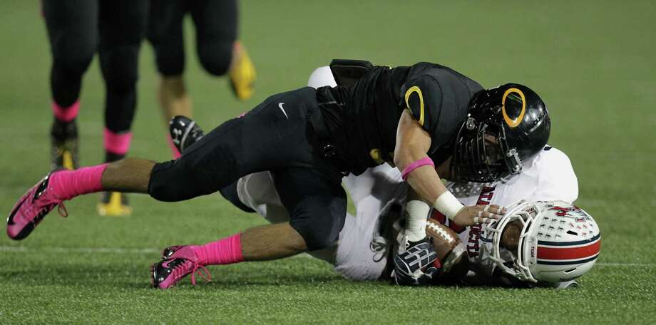 Klein Oak's Tristen Gomez top, tackles Atascocita's JJ Gibson bottom, during the first quarter of high school football game action at Klein Memorial Stadium Thursday, Oct. 10, 2013, in Houston. Photo: James Nielsen, Houston Chronicle / © 2013  Houston Chronicle