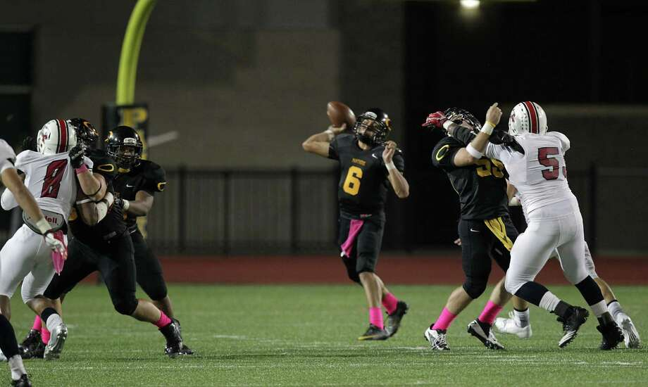 Klein Oak's quarterback Jose Blankenship center, throws a pass against Atascocita during the first quarter of high school football game action at Klein Memorial Stadium Thursday, Oct. 10, 2013, in Houston. Photo: James Nielsen, Houston Chronicle / © 2013  Houston Chronicle