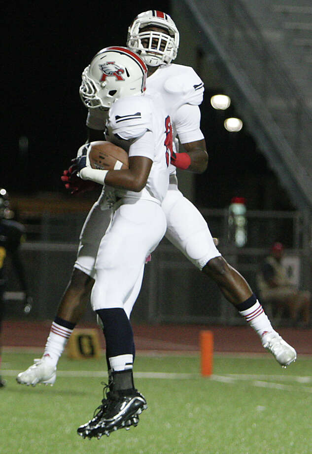 Atascocita's JJ Gibson left, celebrates with teammate Quan Shorts breaks after scoring a touchdown during the first quarter of high school football game action against Atascocita at Klein Memorial Stadium Thursday, Oct. 10, 2013, in Houston. Photo: James Nielsen, Houston Chronicle / © 2013  Houston Chronicle