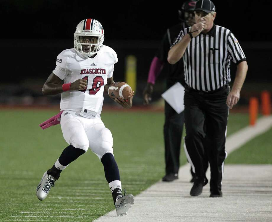 Atascocita's quarterback Greg Campbell runs the ball out of bounds during the first quarter of high school football game action against Klein Oak at Klein Memorial Stadium Thursday, Oct. 10, 2013, in Houston. Photo: James Nielsen, Houston Chronicle / © 2013  Houston Chronicle