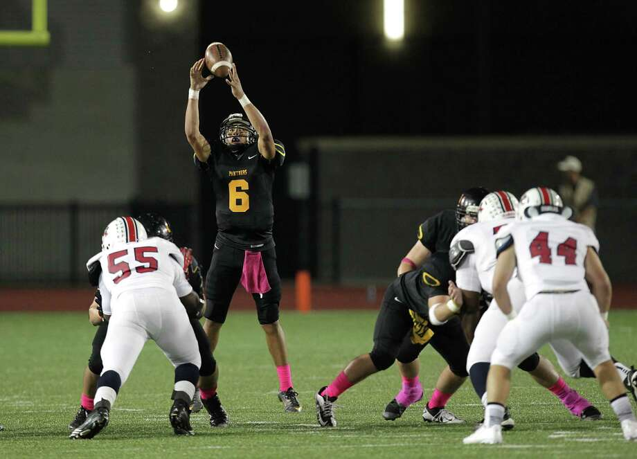 Klein Oak's quarterback Jose Blankenship center, reaches for a snap during the first quarter of high school football game action against Atascocita at Klein Memorial Stadium Thursday, Oct. 10, 2013, in Houston. Photo: James Nielsen, Houston Chronicle / © 2013  Houston Chronicle