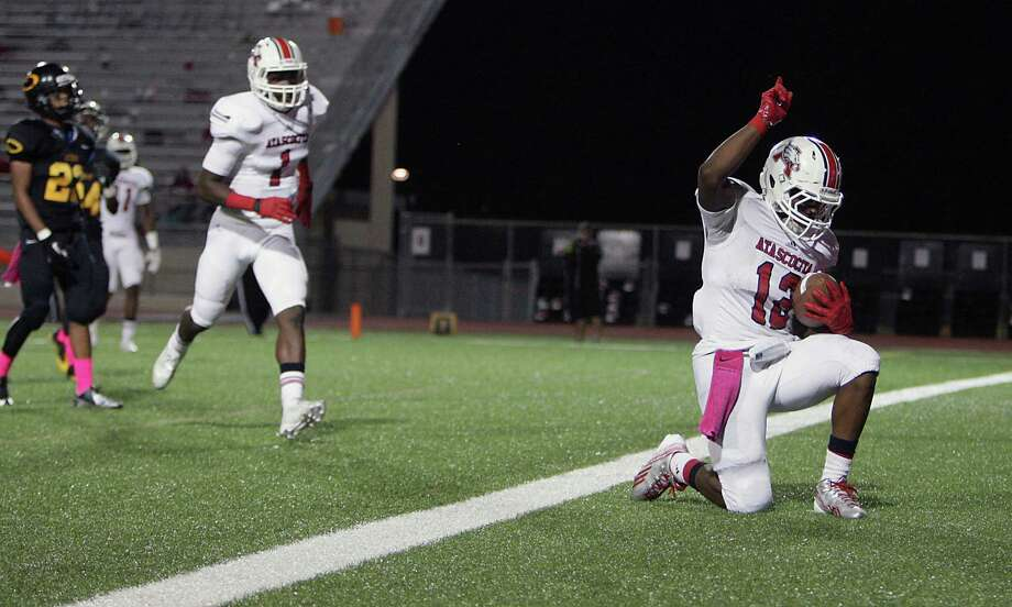 Atascocita's Jemarcus Jones right, kneels down in the end zone after scoring a touchdown against Klein Oak during the second quarter of high school football game action at Klein Memorial Stadium Thursday, Oct. 10, 2013, in Houston. Photo: James Nielsen, Houston Chronicle / © 2013  Houston Chronicle