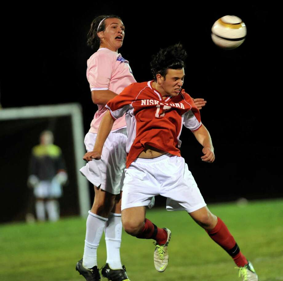 Niskayuna's Luke Faranda, right, beats Shaker's David Riccio to the header during their soccer game on Thursday, Oct. 10, 2013, at Shaker High in Latham, N.Y. (Cindy Schultz / Times Union) Photo: Cindy Schultz / 00024140A