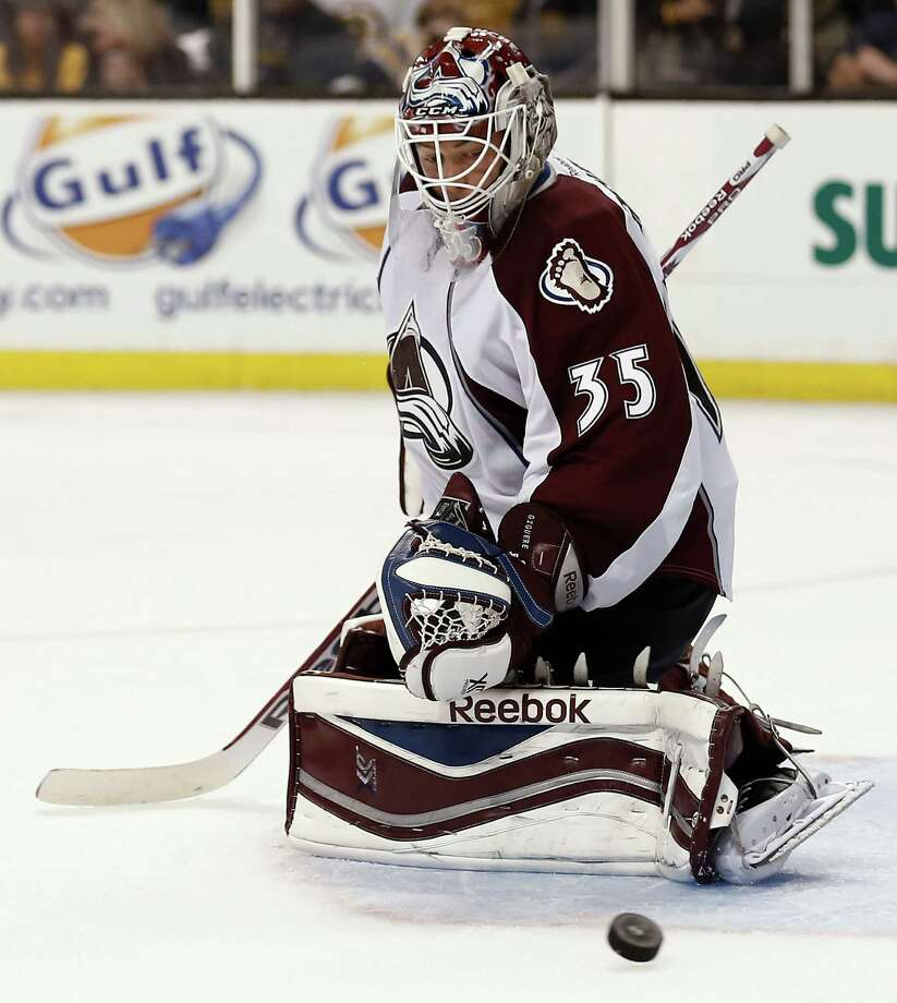 Colorado Avalanche goalie Jean-Sebastien Giguere makes a save against the Boston Bruins during the second period of Colorado's 2-0 win in an NHL hockey game in Boston on Thursday,  Oct. 10, 2013. (AP Photo/Winslow Townson) ORG XMIT: BXG110 Photo: Winslow Townson / FR170221 AP