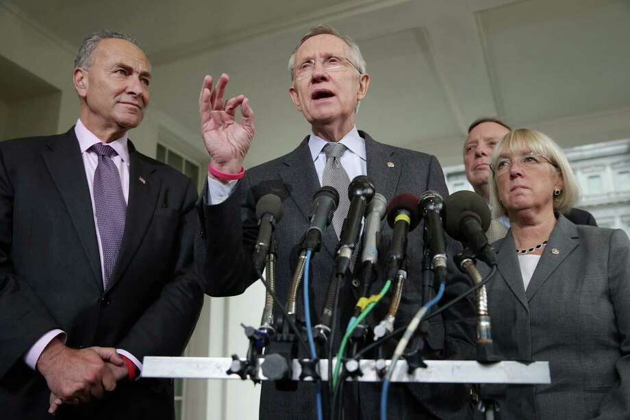 Senate Majority Leader Harry Reid talks to reporters with Sen. Charles Schumer, Senate Majority Whip Richard Durbin and Sen. Patty Murray after meeting with President Barack Obama at the White House last week. Photo: Getty Images / 2013 Getty Images