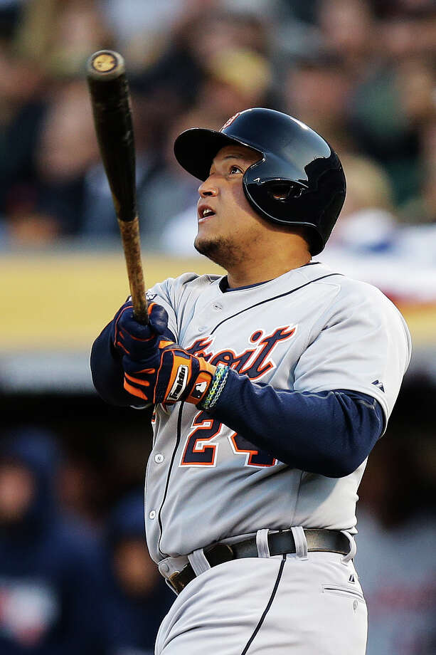 OAKLAND, CA - OCTOBER 10:  Miguel Cabrera #24 of the Detroit Tigers watches his two-run home run in the fourth inning against the Oakland Athletics during Game Five of the American League Division Series at O.co Coliseum on October 10, 2013 in Oakland, California.  (Photo by Ezra Shaw/Getty Images) ORG XMIT: 183104588 Photo: Ezra Shaw / 2013 Getty Images
