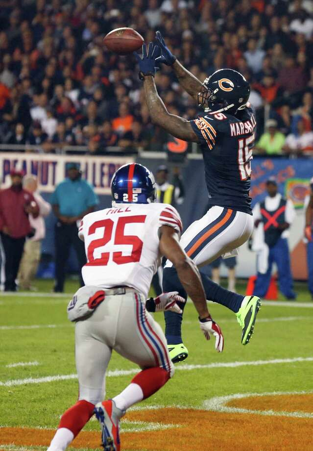 Chicago Bears wide receiver Brandon Marshall (15) makes a touchdown reception against New York Giants defensive back Will Hill (25) in the first half of an NFL football game, Thursday, Oct. 10, 2013, in Chicago. (AP Photo/Charles Rex Arbogast) ORG XMIT: CXB151 Photo: Charles Rex Arbogast / AP