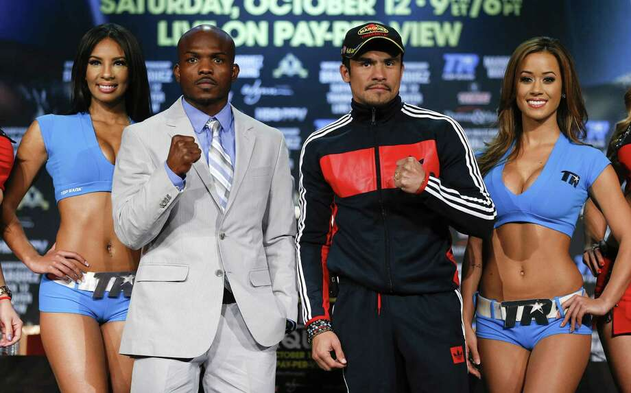 Timothy Bradley (left) and Juan Manuel Marquez pose after a news conference Wednesday to promote Saturday's fight in Las Vegas. Photo: Julie Jacobson / Associated Press