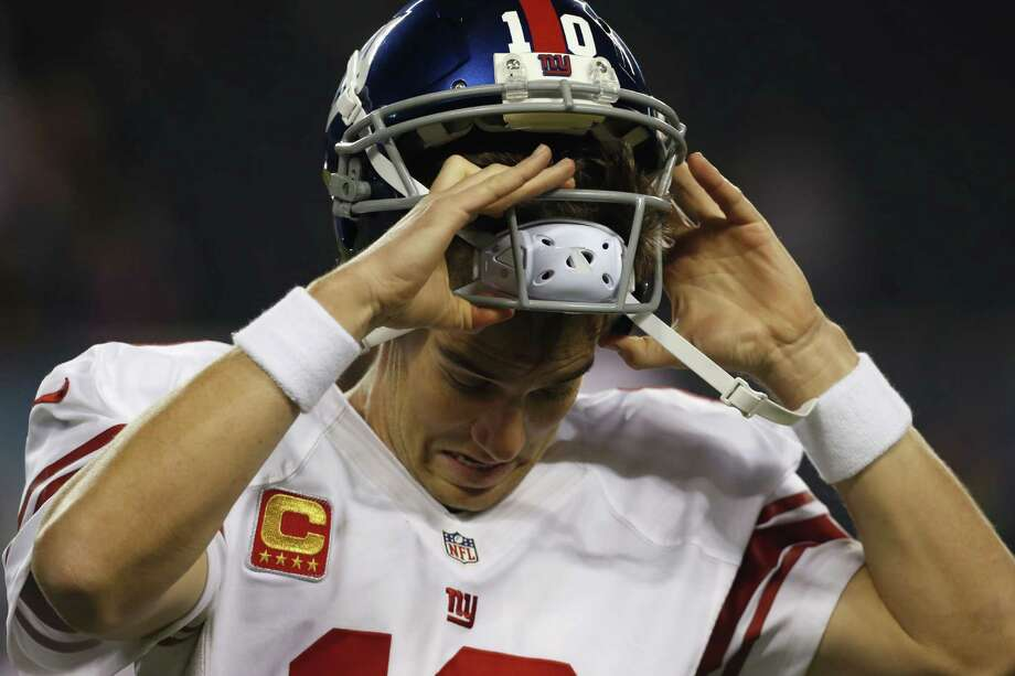 Giants quarterback Eli Manning threw three interceptions as New York dropped to 0-6 for the first time since 1976. Photo: Nam Y. Huh / Associated Press