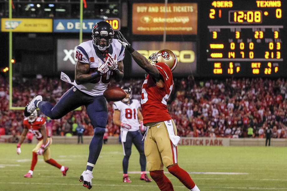 Texans wide receiver Andre Johnson (left) suffered a right shin injury against Baltimore, where Houston's three-game losing streak began. He has 37 catches for 407 yards and no touchdowns. Photo: Brett Coomer / Houston Chronicle