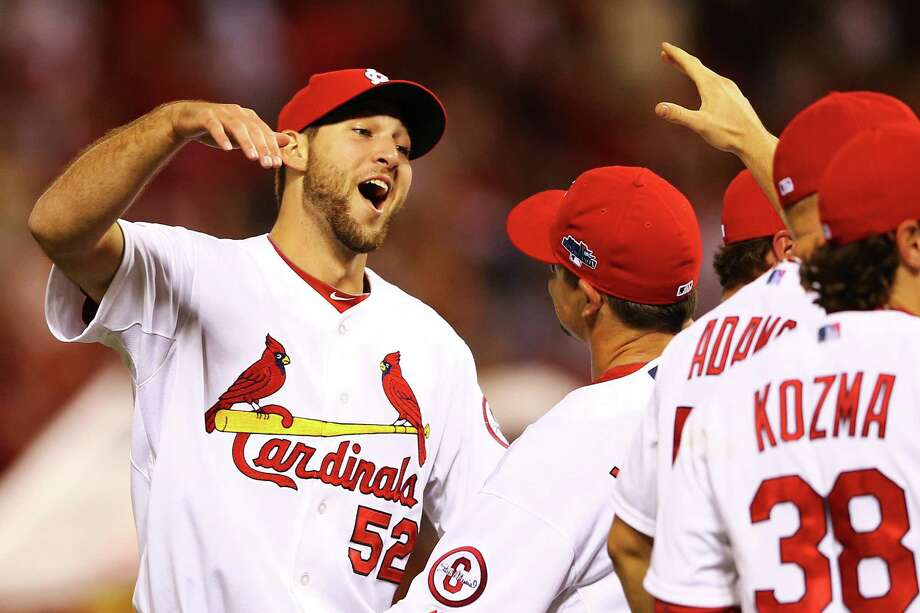 Texas A&M product Michael Wacha (left) has flirted with two no-hitters this postseason for the Cardinals. He's scheduled to start Game 2. Photo: Elsa / Getty Images