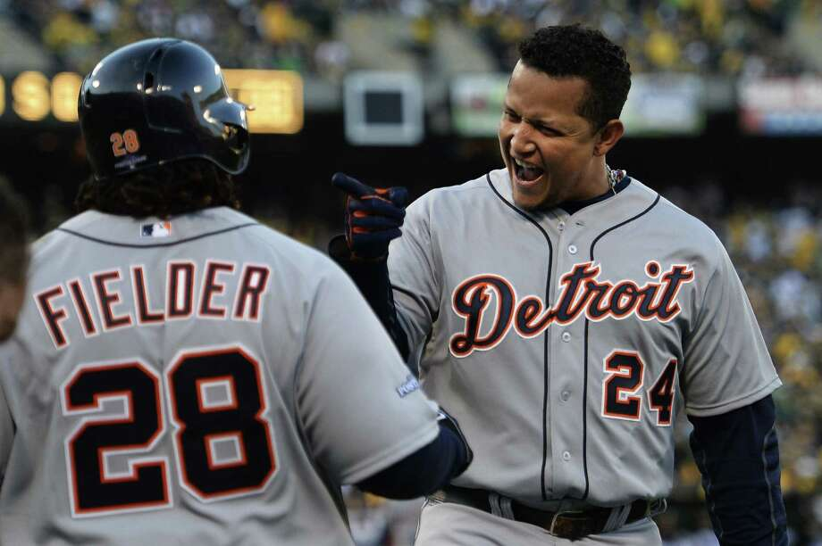 Miguel Cabrera (right) celebrates his two-run homer in the fourth with Prince Fielder. It was Cabrera's first homer since Sept. 17. Photo: Thearon W. Henderson / Getty Images