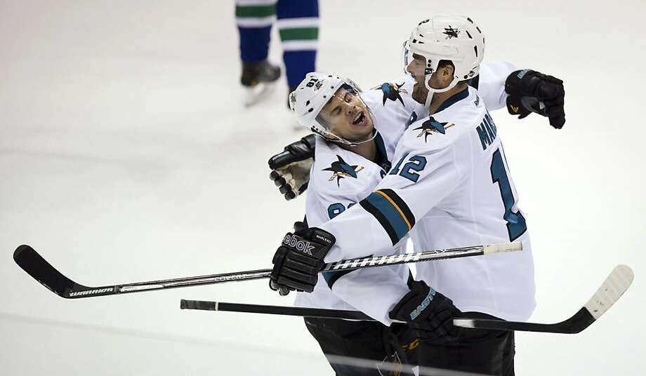 Tyler Kennedy (left) helps Patrick Marleau celebrate his second-period goal in a 4-1 victory. Photo: Darryl Dyck, Associated Press