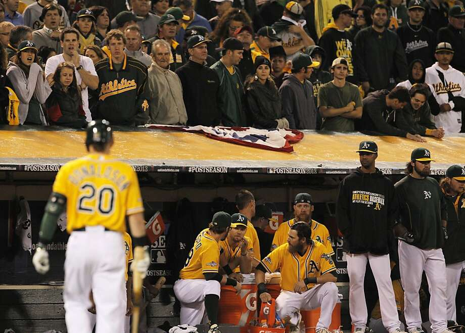 Josh Donaldson returns to the dugout after striking out swinging in the ninth. It was his third strikeout of the game and the A's second-to-last out of the season. Photo: Carlos Avila Gonzalez, The Chronicle