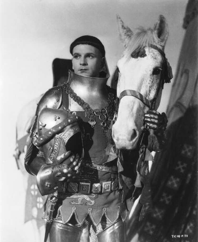 1944:  An armor clad Laurence Olivier in HENRY V.  A heroic treatment, designed to boost British morale during World War II, it is very much of its time -- and ignores clear signs from Shakespeare that Henry was a creep.  He was also invading France and had no business there, so he was less like the British in World War II than the German. Nonetheless, it holds up in its way.  GOOD. Photo: John Kobal Foundation, Getty Images / Moviepix