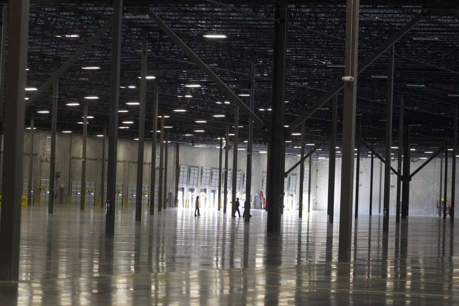Employees walk through the new 420,000 square foot distribution center on Thursday, Oct. 10, 2013, in Katy. ( J. Patric Schneider / For the Chronicle ) Photo: J. Patric Schneider, For The Chronicle