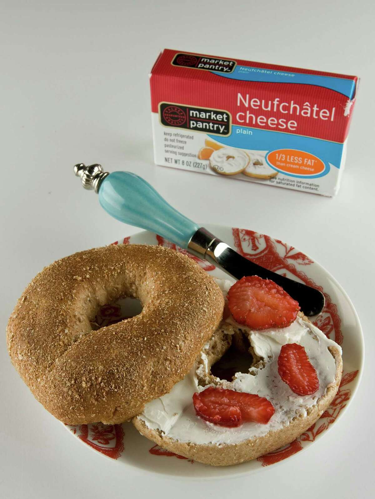 A Thomas whole wheat bagel withMarket Pantry Neufchatel cheese for back to school food feature, photographed in the Houston Chronicle Studio Thursday, July 16, 2009, in Houston. ( James Nielsen / Chronicle )