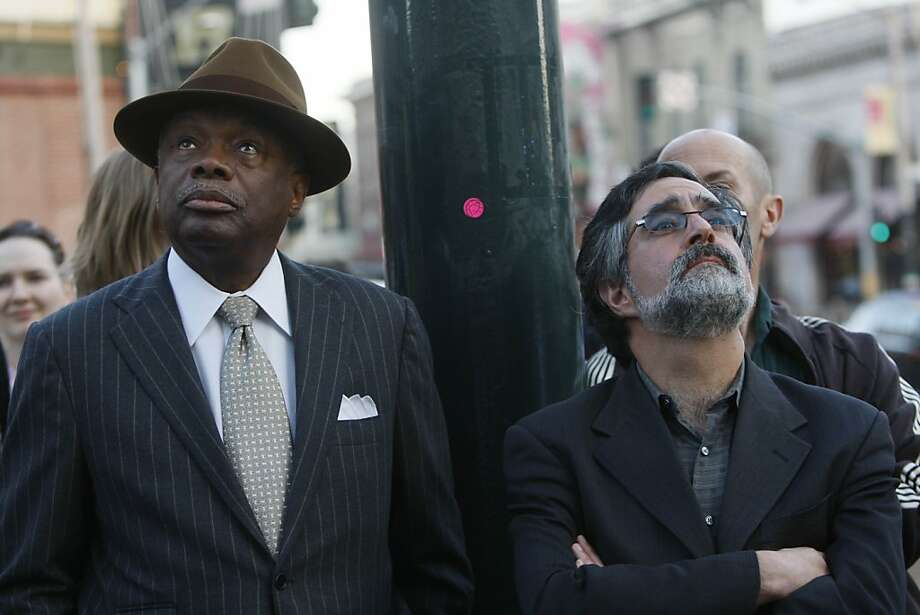 Willie Brown and Aaron Peskin take in the 'Language of the Birds' art project in San Francisco. Brown once compared Peskin to the Peanuts character Pig-Pen. Photo: Lea Suzuki, The Chronicle