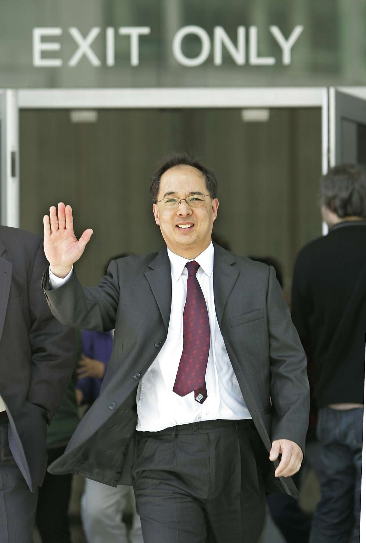 Former San Francisco Supervisor Ed Jew leaves a sentencing hearing at a federal courthouse in San Francisco, Friday, April 3, 2009. Jew has been sentenced to five years and four months in prison for attempting to shake down small city businesses having planning permit problems. He was ensnared in a 2007 FBI sting that videotaped Jew receiving $40,000 in marked bills from an owner of a Quickly fast-food restaurant. He later pleaded guilty to one count each of bribery, extortion and fraud and admitted he tried to force several Quickly owners to pay him a combined $80,000. (AP Photo/Paul Sakuma)