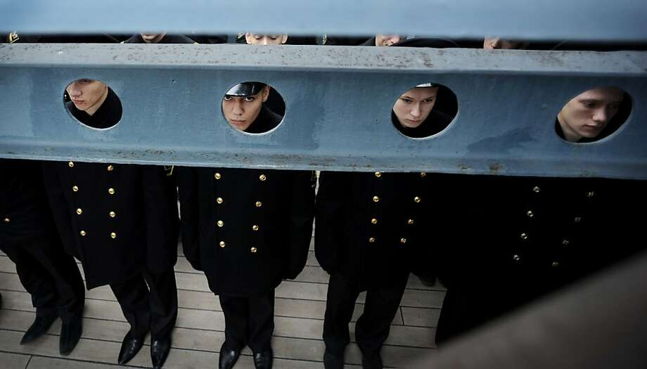 In the navy:Nautical school cadets wait to take their oaths on the deck of the Aurora cruiser, a 1900-era Russian warship turned into a museum, in St. Petersburg. Photo: Olga Maltseva, AFP/Getty Images