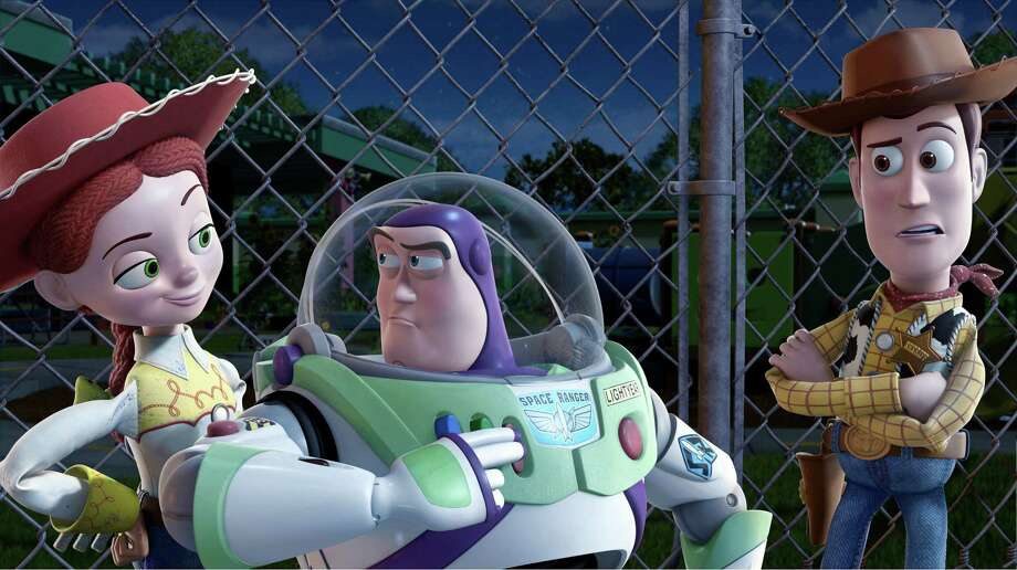 "FILE - In this undated film publicity image released by Disney, from left, Jessie, voiced by Joan Cusack, Buzz Lightyear, voiced by Tim Allen and Woody, voiced by Tom Hanks are shown in a scene from, ""Toy Story 3."" With more than 5,000 fans expected to attend, Disney is teasing several of the studio's upcoming animated movies at the D23 Expo, Aug. 9-11, 2013, a three-day celebration of all things Disney at the Anaheim Convention Center.  (AP Photo/Disney Pixar) ORG XMIT: CAPH361 Photo: Anonymous / Disney"