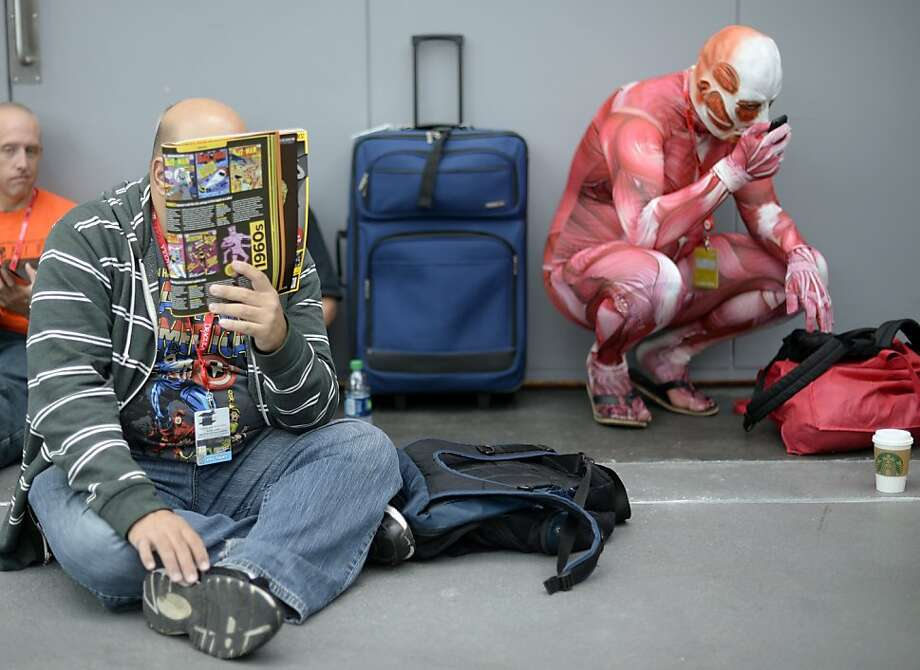 There are two kinds of fans who wait for New York Comic Con to open at Jacob Javits Center in New York - those with skins and those without. Photo: Timothy Clary, AFP/Getty Images
