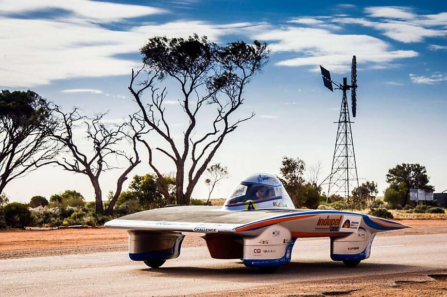 Or Monday or Tuesday if it turns cloudy: The Indupol One solar-powered car of the Belgian team cruises along Stuart Highway in Glendambo, Australia, during the World Solar Challenge. The race will take 43 participants more than 3,000 kilometers before ending Sunday. Photo: Geert Vanden Wijngaert, Associated Press